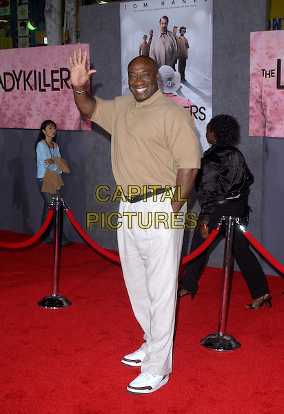 MICHAEL CLARKE DUNCAN  .Los Angeles Premiere of The LadyKillers held at The El Capitan Theatre in Hollywood, California .12 March 2004.*UK Sales Only*.full length, full-length, waving.www.capitalpictures.com.sales@capitalpictures.com.©Capital Pictures.