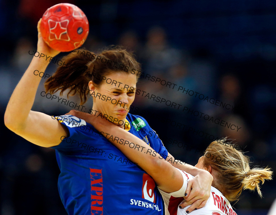 BELGRADE, SERBIA - DECEMBER 11: Linnea Torstenson (L) of Sweden is challenged by Marit Malm Frafjord (R) of Norway during the Women's European Handball Championship 2012 Group I main round match between Norway and Sweden at Arena Hall on December 11, 2012 in Belgrade, Serbia. (Photo by Srdjan Stevanovic/Getty Images)