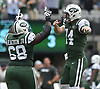 New York Jets quarterback #14 Sam Darnold, right, and teammate Kelvin Beachum #68 celebrate after a 77-yard rushing touchdown by Isaiah Crowell #20 (not in picture) in the second quarter of an NFL game against the Denver Broncos at MetLife Stadium in East Rutherford, NJ on Sunday, Oct. 7, 2018.