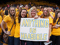 "California fans hold up a sign says ""Anything is Haasible"" before the game against Arizona at Haas Pavilion in Berkeley, California on February 1st, 2014.  California Golden Bears defeated Arizona Wildcats, 60-58."