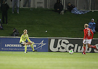 Christie Welsh #13 of the Washington Freedom approaches Allison Whitworth #1 of the Atlanta Beat just before scoring off this play during a WPS match on April 18 2010, at the Maryland Soccerplex, in Boyds, Maryland.