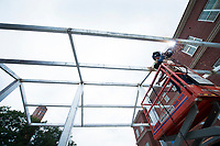 Travis Galliano of McCool-based Blacks Welding welds beams together for an awning outside of Mississippi State University's new Old Main Academic Center. The 150,000-square-foot building, built in the style of the famed Old Main dormitory, is set to begin hosting classes when the fall semester begins Aug. 16.<br /> (photo by Russ Houston / &copy; Mississippi State University)