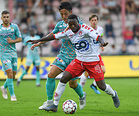 KORTRIJK , BELGIUM - AUGUST 03 : Ryota Morioka of Charleroi pictured in a fight for the ball with Eric Ocansey of Kortrijk during the Jupiler Pro League match day 2 between Kv Kortrijk and Sporting Charleroi on August 03 , 2019 in Kortrijk , Belgium . ( Photo by David Catry / Isosport )
