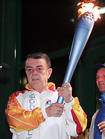 Minos Kyriakou with the Olympic flame for the Torino Winter Olympics. 22 November 2005