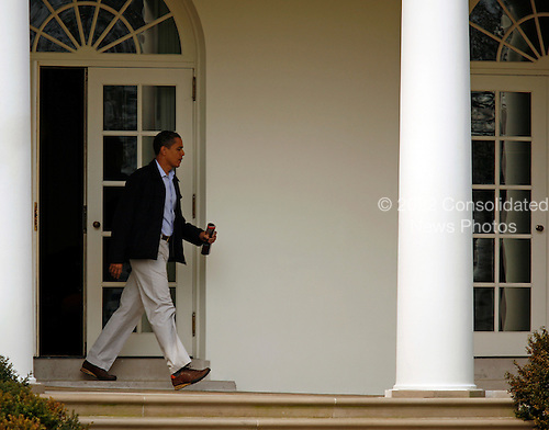 Washington, DC - March 7, 2009 -- United States President Barack Obama leaves the Oval Office moments before meeting wife, Michelle Obama, for their departure from the South Lawn of the White House en route Camp David for the weekend, Saturday, March 7, 2009..Credit: Martin H. Simon / Pool via CNP
