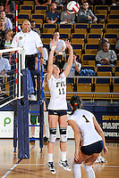 13 November 2010:  FIU's Ines Medved (11) sets the ball in the second set as the FIU Golden Panthers defeated the South Alabama Jaguars, 3-0 (25-12, 25-12, 25-20), at U.S Century Bank Arena in Miami, Florida.