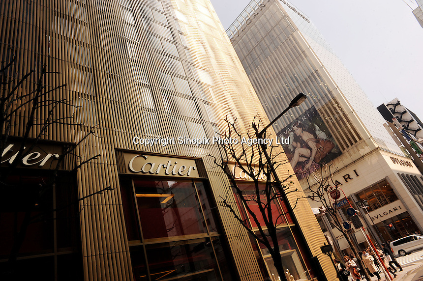 Cartier and BVLGARI in Ginza, Tokyo. The international luxury brands scattered across Ginza have warranted superior architectural facades to attract tourists to visit their stores. .