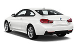 Car pictures of rear three quarter view of a 2019 BMW 4 series M Sport 2 Door Coupe angular rear