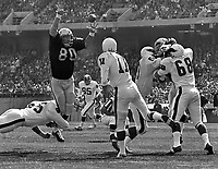 OAKLAND RAIDERS Art Thoms leaps to block pass from Rick Arrington of the Philadelphia Eagles. Left,<br />Carleton Oats is double teamed by Eagles Mark Nordquist and Fred Whittingham. (1971 photo/Ron Riesterer)
