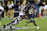 6 November 2010:  FIU running back Darriet Perry (28) attempts to evade Louisiana-Monroe linebacker Cameron Blakes (35) in the fourth quarter as the FIU Golden Panthers defeated the University of Louisiana-Monroe Warhawks, 42-35 in double overtime, at FIU Stadium in Miami, Florida.