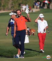 Applause on the last hole fro Joost Luiten (NED) during the Final Round of the 2016 Omega Dubai Desert Classic, played on the Emirates Golf Club, Dubai, United Arab Emirates.  07/02/2016. Picture: Golffile | David Lloyd<br /> <br /> All photos usage must carry mandatory copyright credit (&copy; Golffile | David Lloyd)