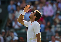 01-07-13, England, London,  AELTC, Wimbledon, Tennis, Wimbledon 2013, Day seven, Juan Martin Del Potro (ARG)<br /> throws a hand kiss in the sky after his win over Andreas Seppi (ITA)<br /> <br /> <br /> <br /> <br /> Photo: Henk Koster