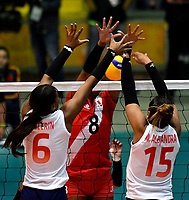 BOGOTÁ-COLOMBIA, 08-01-2020: Valerin Carabalí y María Marín de Colombia, intentan un bloqueo al ataque de balón a Magullaura Frias de Perú, durante partido entre Perú y Colombia en el Preolímpico Suramericano de Voleibol, clasificatorio a los Juegos Olímpicos Tokio 2020, jugado en el Coliseo del Salitre en la ciudad de Bogotá del 7 al 9 de enero de 2020. / Valerin Carabali and Maria Marin from Colombia, trie to block the attack the ball to Magullaura Frias from Peru, during a match between Peru and Colombia, in the South American Volleyball Pre-Olympic Championship, qualifier for the Tokyo 2020 Olympic Games, played in the Colosseum El Salitre in Bogota city, from January 7 to 9, 2020. Photo: VizzorImage / Luis Ramírez / Staff.