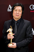 "HONG KONG - MARCH 21:  South Korean director Lee Chang-dong poses backstage after winning the Best Director  Award for his work at the ""Poetry"" during the 5th Asia Film Awards ceremony at the Convention and Exhibition Centre on March 21, 2011 in Hong Kong, China.  Photo by Victor Fraile / studioEAST"