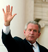 Washington, D.C. - May 29, 2006 -- United States President George W. Bush waves to the assembled following his remarks at the annual Arlington National Cemetery Memorial Day Commemoration at Arlington National Cemetery in Arlington, Virginia  on May 29, 2006. <br /> Credit: Ron Sachs  - Pool via CNP