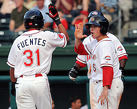 First baseman Christian Vazquez (15), right, high-fives outfielder Reymond Fuentes (31) after both scored against the Augusta GreenJackets in a game on May 20, 2010, at Fluor Field at the West End in Greenville, S.C. Photo by: Tom Priddy/Four Seam Images