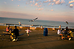 A child chases seagulls on the boardwalk in Hull, Massachusetts.
