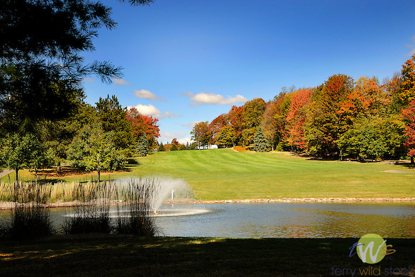 Eagles Mere, PA, golf course in autumn. 5th hole fairway and pond.