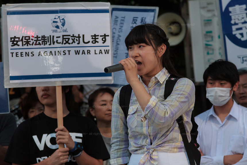 "Teenagers  lead a demo against against the Hawkish administration of Prime Minister, Shinzo Abe, outside the National Diet building in Nagatacho, Tokyo, Japan. Friday June 3rd 2016. Teenagers of the protest group T-nsSOWL called for the right wing Abe to step down and reverse his planned changes to the ""Peace Constitution"" of Japan which would allow the Japanese armed forces to undertake military activities outside Japan for the first time since the World War 2."