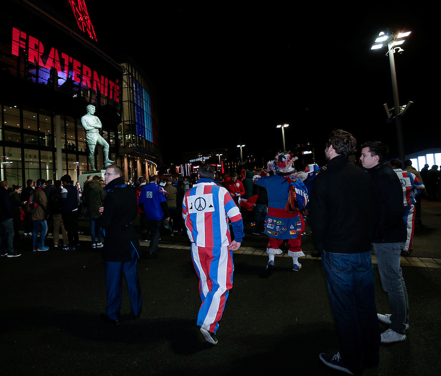 Fans with pictures commemorating the Paris terrorist attacks seen at the Bobby Moore statue outside  Wembley Stadium, home of England football<br /> <br /> Photographer Craig Mercer/CameraSport<br /> <br /> Football International - England v France - Tuesday 17th November 2015 - Wembley Stadium - London<br /> <br /> &copy; CameraSport - 43 Linden Ave. Countesthorpe. Leicester. England. LE8 5PG - Tel: +44 (0) 116 277 4147 - admin@camerasport.com - www.camerasport.com