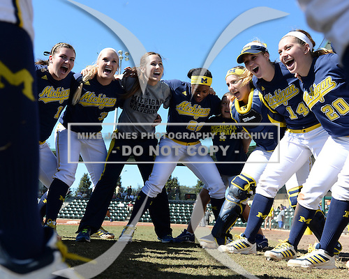 Michigan Wolverines Softball team huddle, including pitcher Megan Betsa (3), outfielder Sierra Lawrence (22), catcher Lauren Connell (14), outfielder Mary Sbonek (20), before a game against the Bethune-Cookman on February 9, 2014 at the USF Softball Stadium in Tampa, Florida.  Michigan defeated Bethune-Cookman 12-1.  (Copyright Mike Janes Photography)