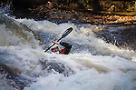 November 5, 2016 - Hendersonville, North Carolina, U.S. -  A kayaker drops deep into the Scream Machine Rapids during the 21st annual Green Race.The Green River Narrows provides one of the most intense and extreme whitewater venues in the world and is home to many of the USA's most talented paddlers.  Green River Narrows, Hendersonville, North Carolina.