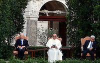 Da sinistra, il presidente israeliano Shimon Peres, Papa Francesco ed il presidente palestinese Mahmoud Abbas prendono parte all'Invocazione per la Pace in Medio Oriente, nei Giardini della Citta' del Vaticano, 8 giugno 2014.<br /> From left, Israeli President Shimon Peres, Pope Francis and Palestinian President Mahmoud Abbas attend the prayer meeting for peace in Middle East at the Vatican Garden 8 June 2014.<br /> UPDATE IMAGES PRESS/Isabella Bonotto<br /> <br /> STRICTLY ONLY FOR EDITORIAL USE