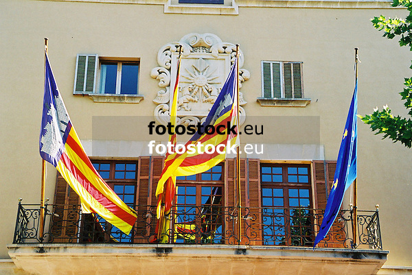 Flags of the Balearic Islands, Spain and the European Union at the balcony of the town hall of S&oacute;ller<br /> <br /> Banderas de las Islas Baleares, Espa&ntilde;a y Europa en el balc&oacute;n del Ayuntamiento de S&oacute;ller<br /> <br /> Fahnen der Balearen, Spanien und Europa am Balkon des Rathauses von S&oacute;ller<br /> <br /> 1840 x 1232 px