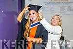 Clodagh Ryan getting help from mom Jackie, before she graduates from the I T Tralee on Friday.