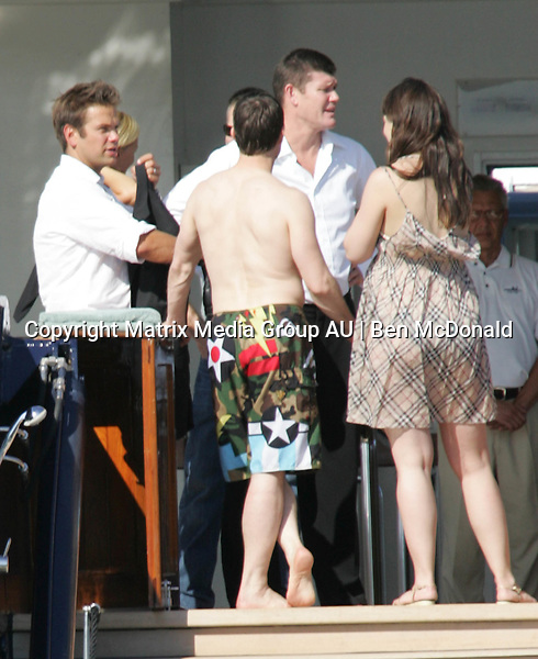 17 FEBRUARY 2006 SYDNEY AUSTRALIA<br /> <br /> Tom Cruise and Katie Holmes on the Artic P after swimming in Sydney Harbour following the memorial service of the Late Kerry Packer. James Packer is pictured with his wife Erica and close friends Lachlan & Sarah Murdoch