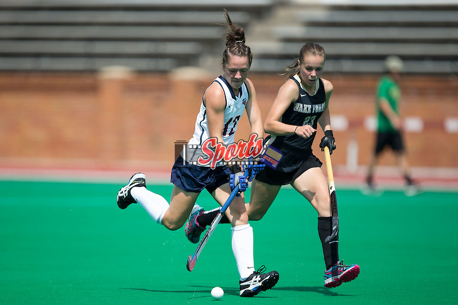 Bethany Barr (12) of the Liberty Flames keeps the bal away from Megan Anderson (23) of the Wake Forest Demon Deacons during second half action at Kentner Stadium on September 20, 2015 in Winston-Salem, North Carolina.  The Demon Deacons defeated the Flames 2-1.  (Brian Westerholt/Sports On Film)
