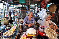Two elderly ladies sharing a joke, Cho Vung Tau (Vung Tau Market), Vung Tau, Vietnam