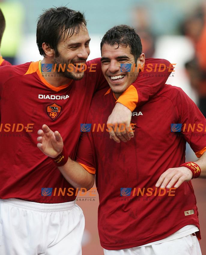 As Roma team group<br /> Italian &quot;Serie A&quot; 2006-07<br /> 11 Feb 2007 (Match Day 23)<br /> Roma-Parma (3-0)<br /> &quot;Olimpico&quot;-Stadium-Roma-Italy<br /> As Roma Midfielder Simone Perrotta (R) celebrates after scoring with teammates Mirko Cassetti (L)<br /> Esultanza di Simone Perrotta dopo il gol<br /> Photographer: Andrea Staccioli INSIDE