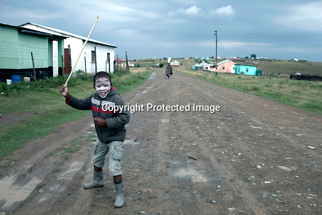 MVEZO, SOUTH AFRICA - MARCH 28: A boy plays with a stick on the main road on March 28, 2012 in Mvezo South Africa. Nelson Mandela was born in this rural village in 1918 and moved to nearby Qunu as a young boy. Qunu is about 32 kilometers away. The village is now headed by his grandson Mandla Mandela. (Photo by Per-Anders Pettersson)