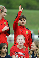 Piscataway, NJ, May 7, 2016.  Samantha Mewis 5) and Ga Eul Jeon (7) of the Western New York Flash during player introductions prior to their game with Sky Blue FC.  The Western New York Flash defeated Sky Blue FC, 2-1, in a National Women's Soccer League (NWSL) match at Yurcak Field.