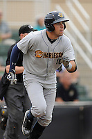 Left fielder Michael O'Neill (10) of the Charleston RiverDogs in a game against the Kannapolis Intimidators on Saturday, June 28, 2014, at CMC-Northeast Stadium in Kannapolis, North Carolina. Kannapolis won, 4-3. (Tom Priddy/Four Seam Images)