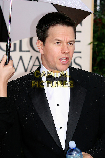 MARK WAHLBERG.Arrivals at the 67th Golden Globe Awards, he Beverly Hilton Hotel, Beverly Hills, California, USA. .January 17th, 2010 .globes half length black bow tie tuxedo tux umbrella mouth open raining water bottle.CAP/AW/MAZ .©Maz/Weber/Capital Pictures..