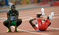 19 AUG 2008 - BEIJING, CHN - Saul Weipogwa (NGR) and Andretti Collazo (CUB) wait for the results of their 400m semi finals - Day Eleven - Beijing Olympics. (PHOTO (C) NIGEL FARROW) *** IOC RULES APPLY ON USAGE ***