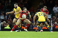 Pictured: of Wales (C) attempt to avoid a tackle by Will Genia of Australia (22)  Saturday 08 November 2014<br />