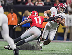 Georgia Bulldogs linebacker Davin Bellamy (17) slides in to tackle Alabama Crimson Tide quarterback Tua Tagovailoa (13) in the second half of the NCAA College Football Playoff National Championship at Mercedes-Benz Stadium on January 8, 2018 in Atlanta. Alabama defeated Georgia 26-23 in overtime.  Photo by Mark Wallheiser/UPI