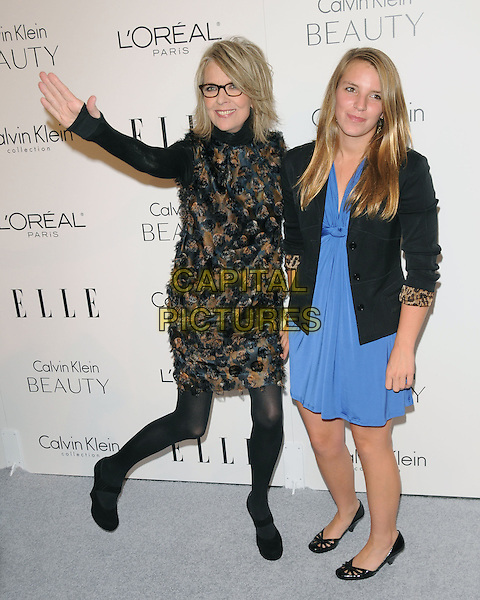 DIANE KEATON & daughter .walks the carpet as Elle Honors Hollywood's Most Esteemed Women in the 17th Annual Women in Hollywood Tribute held at The Four Seasons Beverly Hills in Beverly Hills, California, USA, October 18th 2010..full length hand waving family blue dress jacket black glasses smiling polo neck brown blue print .CAP/RKE/DVS.©DVS/RockinExposures/Capital Pictures.