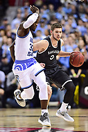 Washington, DC - MAR 11, 2018: Rhode Island Rams guard Jared Terrell (32) guards Davidson Wildcats guard Jon Axel Gudmundsson (3) as he brings the ball up court during the Atlantic 10 men's basketball championship between Davidson and Rhode Island at the Capital One Arena in Washington, DC. (Photo by Phil Peters/Media Images International)