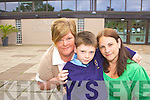 Ronan Galvin Killarney who will lose his special needs teacher in St Olivers NS Killarney due to Government cut backs in education with his mum Lorraine and his nan Liz at the school on Wednesday