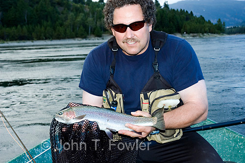 Landing rainbow trout on Columbia River at Castlegar, British Columbia<br />