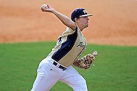 22 April 2012:  FIU pitcher Christian Malbrough (26) pitches in relief while the rain begins to fall as the University of Arkansas Little Rock Trojans defeated the FIU Golden Panthers, 7-6, at University Park Stadium in Miami, Florida.