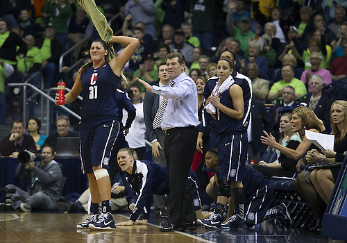 March 04, 2013:  Connecticut center Stefanie Dolson (31) and Connecticut head coach Geno Auriemma react to a call during NCAA Basketball game action between the Notre Dame Fighting Irish and the Connecticut Huskies at Purcell Pavilion at the Joyce Center in South Bend, Indiana.  Notre Dame defeated Connecticut 96-87 in triple overtime.
