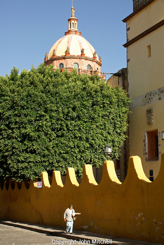 Person carrying a tray in San Miguel de Allende, Mexico. San Miguel de Allende is a UNESCO World Heritage Site....