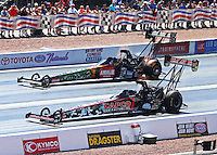 Apr 12, 2015; Las Vegas, NV, USA; NHRA top fuel driver Steve Torrence (near lane) races alongside Terry McMillen during the Summitracing.com Nationals at The Strip at Las Vegas Motor Speedway. Mandatory Credit: Mark J. Rebilas-