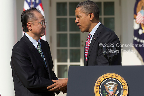 United States President Barack Obama, right, shakes hands with Jim Yong Kim, president of Dartmouth College and nominee to become president of the World Bank, in the Rose Garden of the White House in Washington, D.C., U.S., on Friday, March 23, 2012. Kim was born in Seoul and is a U.S. citizen. He would succeed Robert Zoellick as the head of the bank. The bank made $57 billion loans in the last fiscal year. .Credit: Andrew Harrer / Pool via CNP