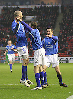 Sam Parkin (left) and Alan Reid (right) delighted with goalscorer Scott McLaughlin in the Aberdeen v Queen of the South William Hill Scottish Cup 5th Round match played at Pittodrie Stadium, Aberdeen on 4.2.12.